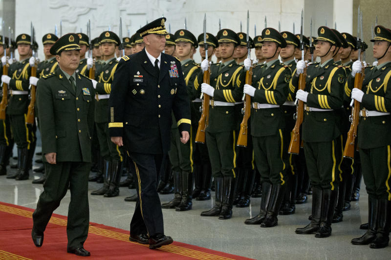 U.S. Army Chief of Staff Gen. Raymond Odierno, front right and Gen. Wang Ning, front left, deputy Chief Staff of the People's Liberation Army (PLA), review an honor guard at China's Ministry of Defense in Beijing, Friday, Feb. 21, 2014. The U.S. Army chief met with top Chinese generals in Beijing Friday amid regional tensions and efforts to build trust between the two nation's militaries. (AP Photo/Alexander F. Yuan, Pool)
