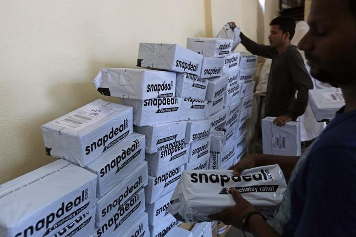 Employees of Snapdeal, an Indian online retailer, sort out delivery packages inside their company fulfillment centre in Mumbai