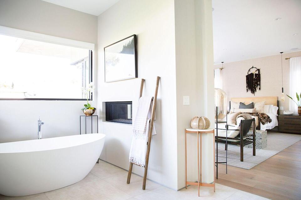 """<p>If you're building from scratch, consider adding an extra perk for bonus cozy vibes. Translation: a gas fireplace next to the bathtub. In this space designed by <a href=""""http://www.petilau.com/"""" rel=""""nofollow noopener"""" target=""""_blank"""" data-ylk=""""slk:Peti Lau"""" class=""""link rapid-noclick-resp"""">Peti Lau</a>, the bathroom and bedroom share a wall, so the connecting fireplace insert provides warmth, style, and romance to both sides. </p>"""