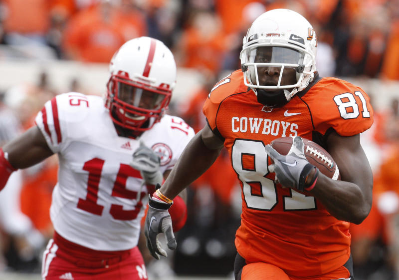 Oklahoma State wide receiver Justin Blackmon, right, carries a Brandon Weeden pass into the endzone for a touchdown as Nebraska defender Alfonzo Denard, left, gives chase, in the second quarter of an NCAA college football game in Stillwater, Okla., Saturday, Oct. 23, 2010. (AP Photo/Sue Ogrocki)