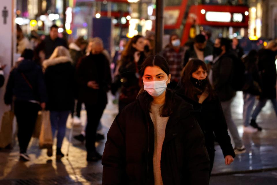 A shopper wearing a protective face covering to combat the spread of the coronavirus, walks along Oxford Street in central London on December 14, 2020, as it is announced that Greater London will be moved into Tier 3 from Tier 2 from Wednesday December 16. - London is to move into the highest level of anti-virus restrictions, the health minister announced Monday. The British capital from Wednesday will go into