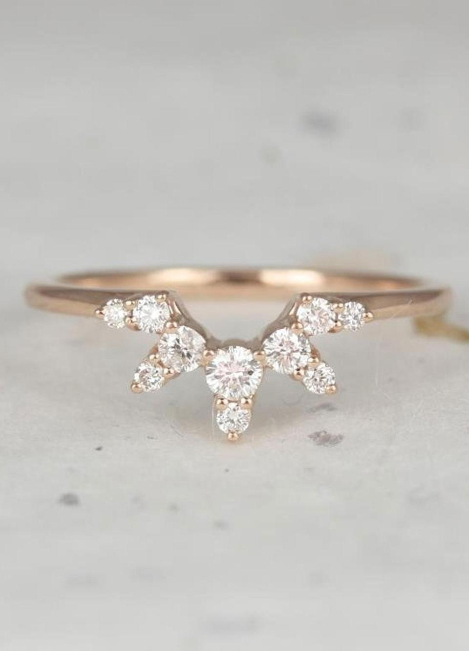 """Isom Johnson highlights nesting bands—stackable rings you layer with an engagement ring to enhance its shape or create a more embellished effect (also known as tiara bands or suits) as one of the most unique styles on the rise on Etsy. $695, Etsy. <a href=""""https://www.etsy.com/listing/662282149/rosados-box-lucia-14kt-rose-gold-tiara?ga_search_query=nesting&ref=shop_items_search_4&frs=1"""" rel=""""nofollow noopener"""" target=""""_blank"""" data-ylk=""""slk:Get it now!"""" class=""""link rapid-noclick-resp"""">Get it now!</a>"""
