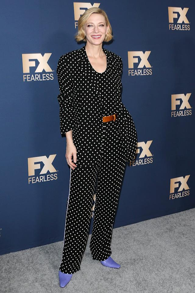 wears a Haider Ackermann polka dot suit, styled with a brown belt and Dorateymur powder blue ankle boots at FX Networks' Star Walk Winter Press Tour 2020 in Pasadena, C.A.