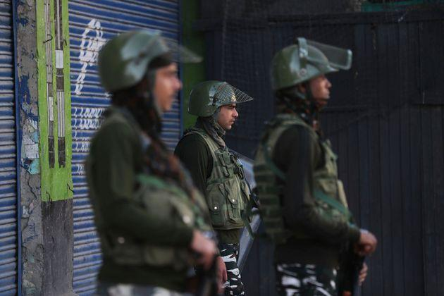 Indian paramilitary soldiers guard at a closed market in Srinagar, Kashmir, Wednesday, Aug. 21, 2019.