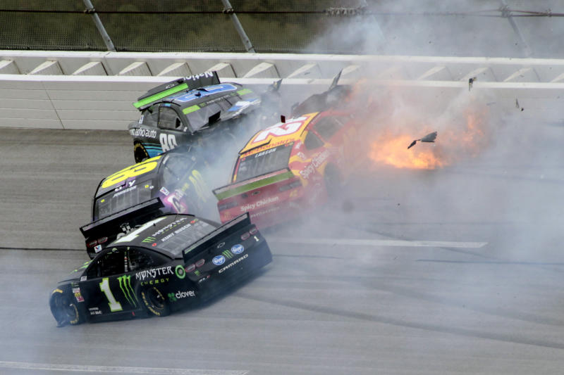 That's Kyle Larson's car in yellow and red. (AP Photo/Greg McWilliams)