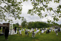 Mourners attend a socially distanced outdoor memorial service for Joanne Paylor, 62, of Washington, during her funeral at Cedar Hill Cemetery, Suitland-Silver Hill, Md., Sunday, May 3, 2020. Despite not having died from coronavirus, almost every aspect of Paylor's funeral has been impacted by the pandemic. (AP Photo/Jacquelyn Martin)