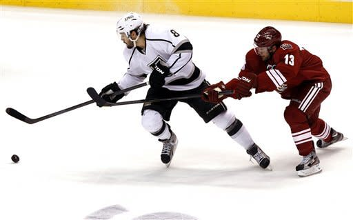 Los Angeles Kings defenseman Drew Doughty (8) battles Phoenix Coyotes left wing Ray Whitney (13) for the puck during the first period of Game 2 of the NHL hockey Stanley Cup Western Conference finals, Tuesday, May 15, 2012, in Glendale, Ariz. (AP Photo/Ross D. Franklin)