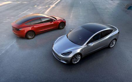 FILE PHOTO - Tesla Motors' mass-market Model 3 electric cars are seen in this handout picture from Tesla Motors on March 31, 2016.   Tesla Motors/Handout via REUTERS/File Photo