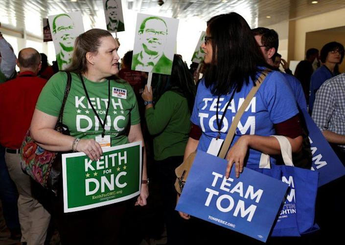 Supporters of Rep. Keith Ellison and former Secretary of Labor Tom Perez speak to each other during a Democratic National Committee forum in Baltimore. (Photo: Joshua Roberts/Reuters)