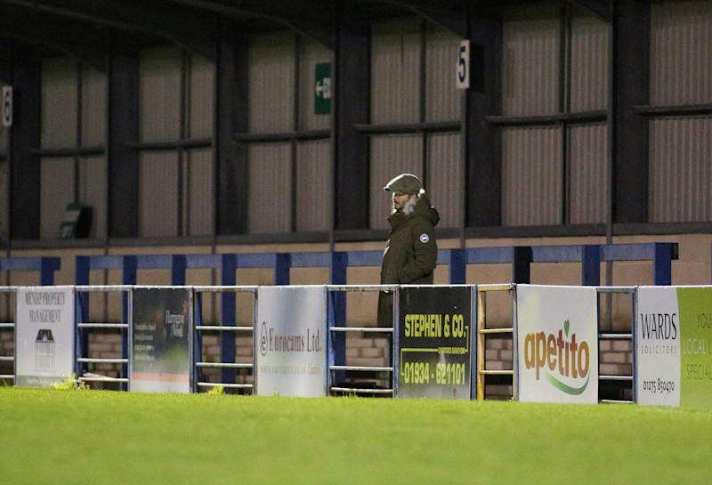 Beckham was seen standing alone for much of the match. (Jon Mills / SWNS)