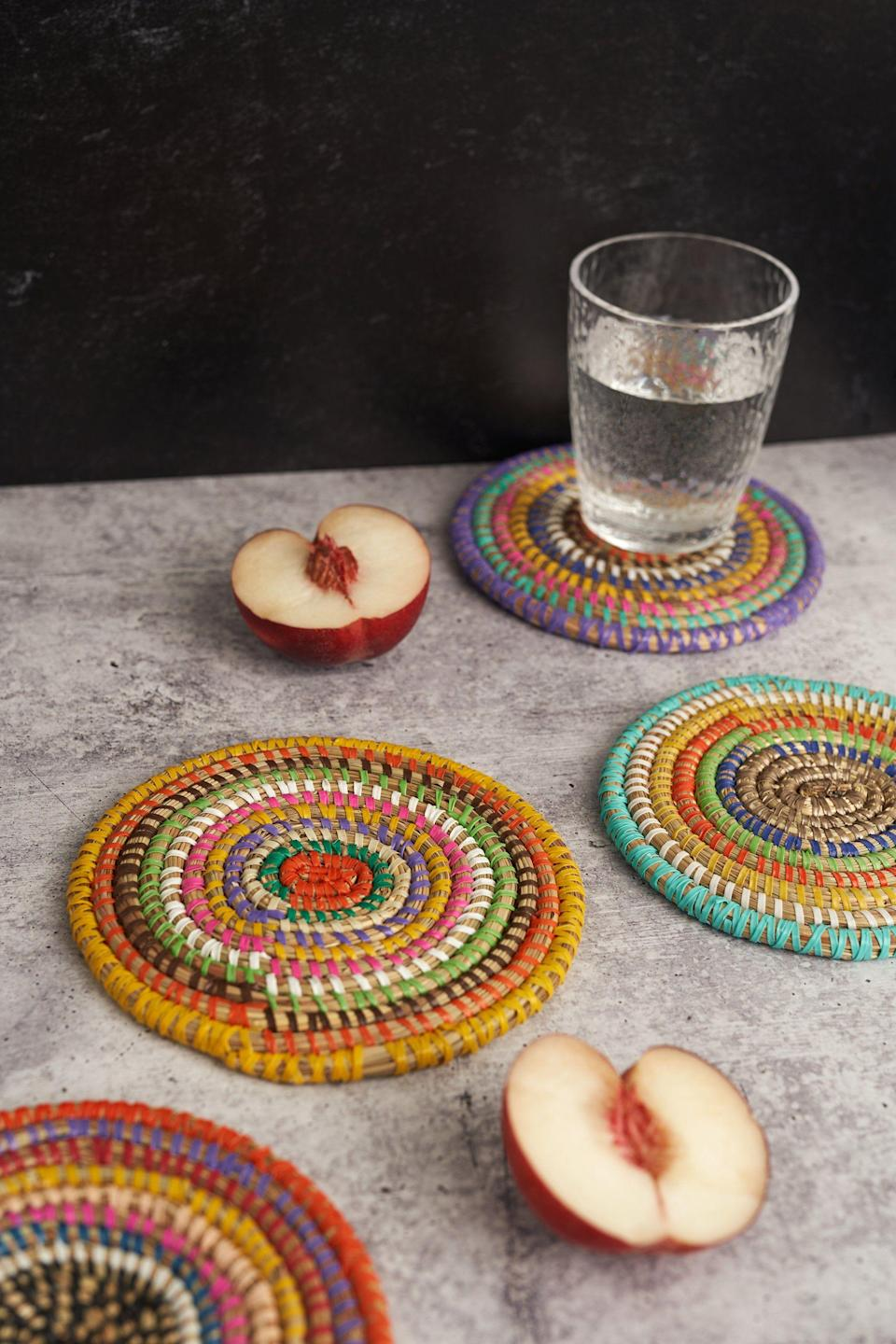 """<p>expeditionsubsahara.com</p><p><strong>$39.00</strong></p><p><a href=""""https://expeditionsubsahara.com/collections/coasters/products/zalipah-woven-coasters-set-of-4"""" rel=""""nofollow noopener"""" target=""""_blank"""" data-ylk=""""slk:Shop Now"""" class=""""link rapid-noclick-resp"""">Shop Now</a></p><p>Add a pop of color to your host's home with these woven coasters, handmade in Senegal. </p>"""
