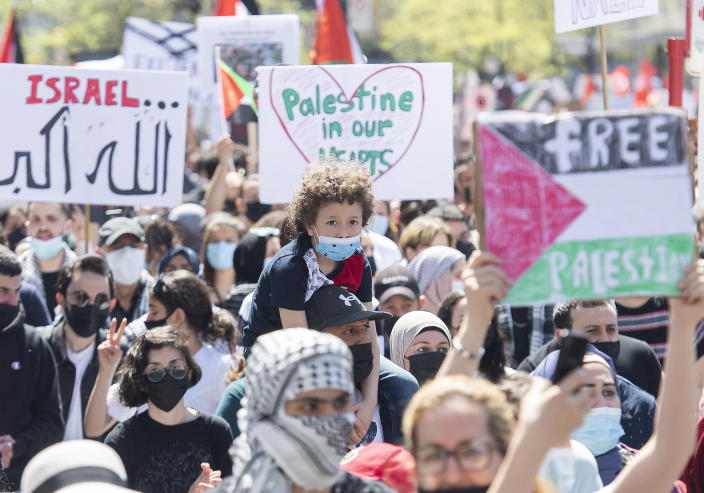 People in Montreal attend a demonstration on Saturday, May 15, 2021, to denounce Israel's military actions in the Palestinian territories. (Graham Hughes/The Canadian Press via AP)