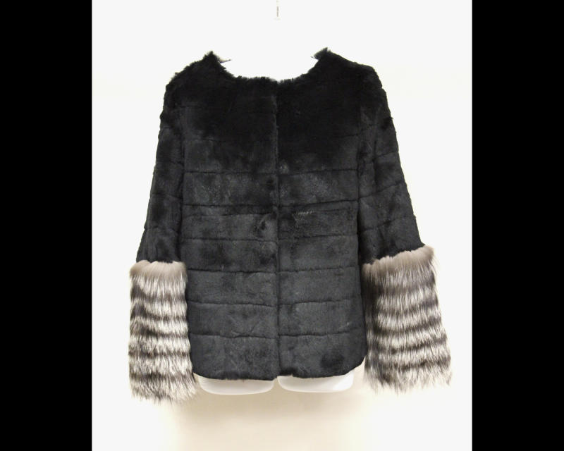 This undated photo provided by Texas-based Gaston & Sheehan Auctioneers, Inc. shows a woman's mink jacket with silver-fox sleeves that once belonged to former Illinois Congressman Jesse Jackson Jr. and his wife Sandi. It is among the items U.S. Marshals Service started selling in an online auction Tuesday, Sept. 17, 2013, in its attempt to recoup part of the $750,000 in campaign funds the Chicago Democrat and his wife illegally spent. Both were handed prison terms last month. The auction runs through Sept. 26. (AP Photo/Courtesy Gaston and Sheehan Auctioneers, Inc.)