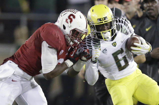 namStanford safety Jordan Richards, left, pushes Oregon running back De'Anthony Thomas (6) out of bounds during the second quarter of an NCAA college football game in Stanford, Calif., Thursday, Nov. 7, 2013. (AP Photo/Marcio Jose Sanchez)