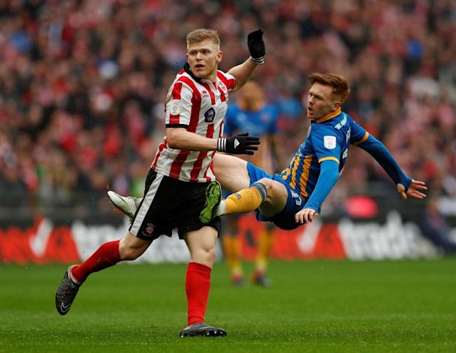 "Soccer Football - Checkatrade Trophy Final - Lincoln City vs Shrewsbury Town - Wembley Stadium, London, Britain - April 8, 2018 Shrewsbury Town's Jon Nolan in action with Lincoln City's Elliott Whitehouse Action Images/Andrew Boyers EDITORIAL USE ONLY. No use with unauthorized audio, video, data, fixture lists, club/league logos or ""live"" services. Online in-match use limited to 75 images, no video emulation. No use in betting, games or single club/league/player publications. Please contact your account representative for further details."
