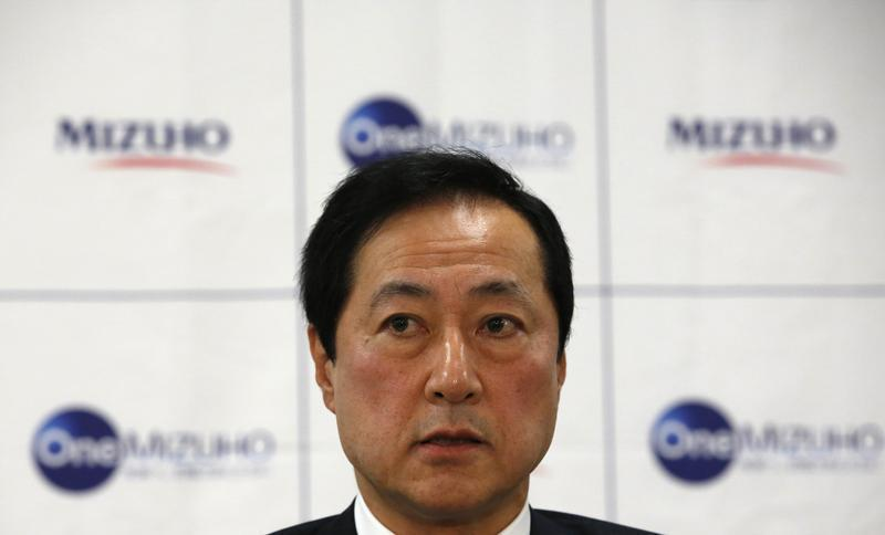 Mizuho Financial Group President and CEO Sato speaks during a news conference on the merging of Mizuho Bank and Mizuho Corporate Bank in Tokyo