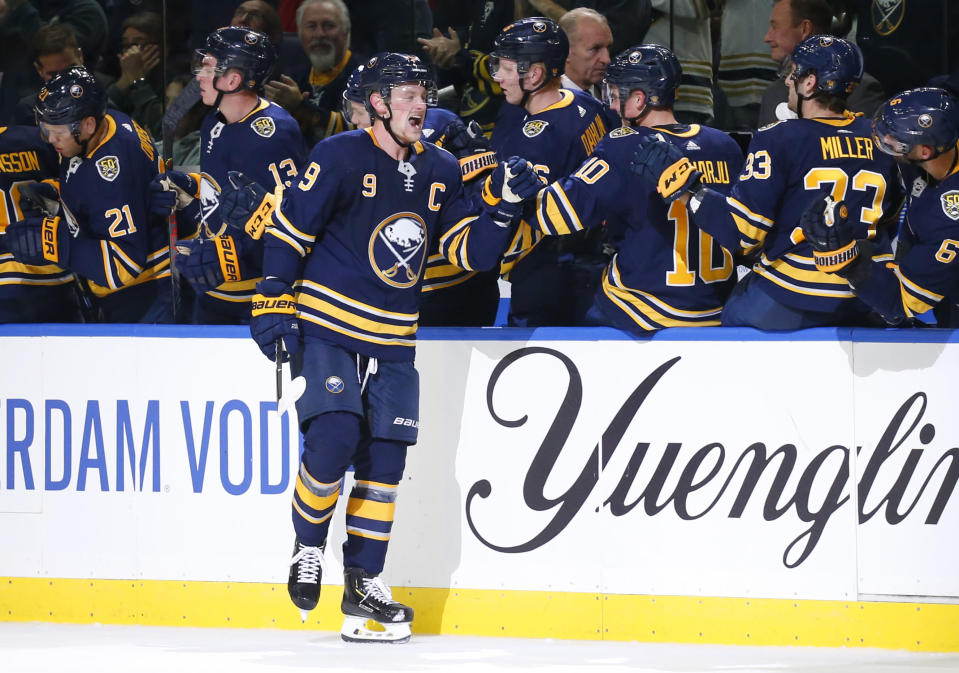 Buffalo Sabres forward Jack Eichel (9) celebrates his goal during the second period of the team's NHL hockey game against the Montreal Canadiens, Wednesday, Oct. 9, 2019, in Buffalo, N.Y. (AP Photo/Jeffrey T. Barnes)