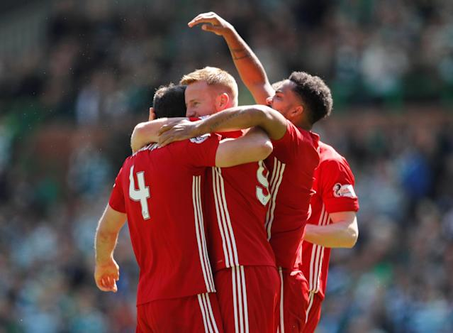 Soccer Football - Scottish Premiership - Celtic vs Aberdeen - Celtic Park, Glasgow, Britain - May 13, 2018 Aberdeen's Andrew Considine and Adam Rooney celebrate at the end of the match REUTERS/Russell Cheyne