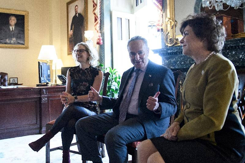 US Senate Minority Leader Chuck Schumer, center, meets with Democratic senators-elect Kyrsten Sinema of Arizona, left, and Jacky Rosen of Nevada in his US Capitol office on November 13, 2018