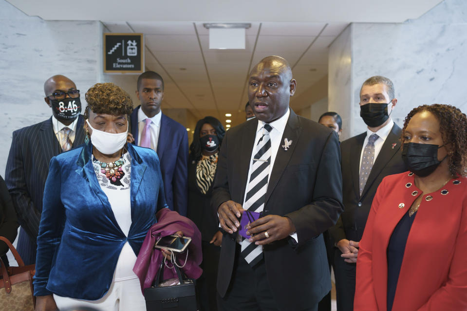 Civil rights attorney Ben Crump, who represented the George Floyd family, is joined by family members of victims of racial injustice following a meeting with Sen. Tim Scott, R-S.C., who is working on a police reform bill in the Senate, at the Capitol in Washington, Thursday, April 29, 2021. At left are Philonise Floyd, brother of George Floyd who was killed by Minneapolis police during an arrest, and Gwen Carr, mother of Eric Garner who was killed by a New York Police Department officer using a prohibited chokehold during his arrest. (AP Photo/J. Scott Applewhite)