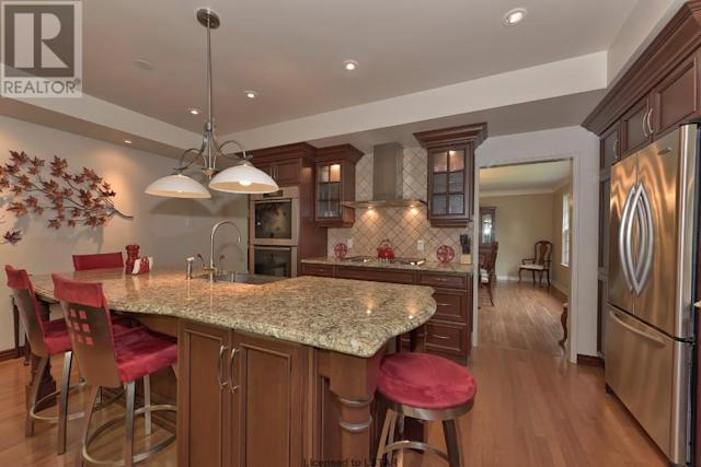 <p><span>1058 Fraser Ave., London, Ont.</span><br> The gourmet kitchen features granite counters, a second sink for prep, cherry cabinetry and a Miele five-burner gas cooktop, all adjoining a formal dining room.<br> (Photo: Zoocasa) </p>