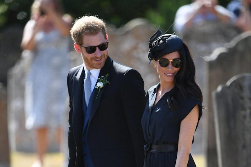 Prince Harry and Meghan Markle attend a friend's wedding in Surrey (PA)