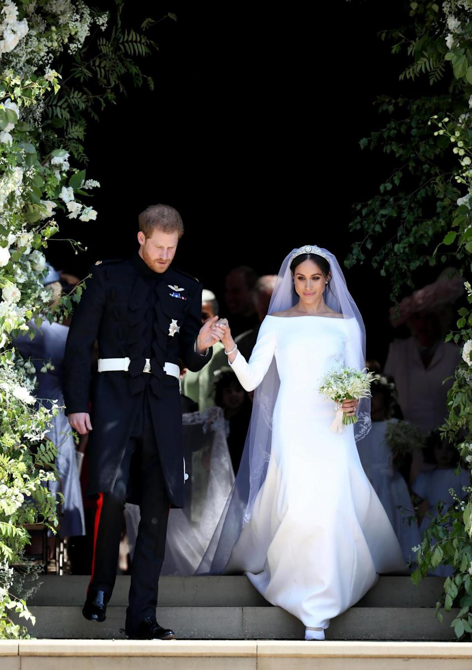 Prince Harry and Meghan Markle leave St George's Chapel in Windsor Castle after their wedding. (PA Wire/PA Images)