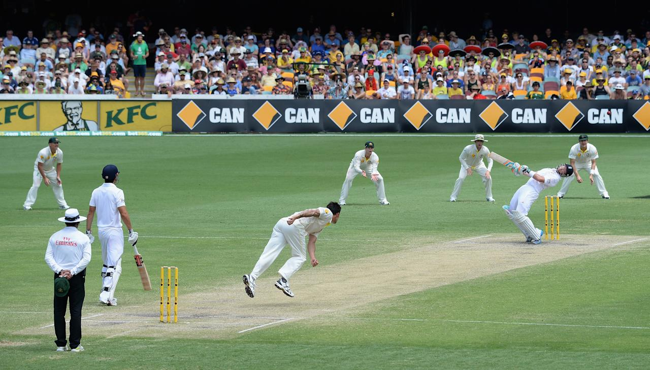 BRISBANE, AUSTRALIA - NOVEMBER 24:  Ian Bell of England avoids a short ball from Mitchell Johnson of Australia during day four of the First Ashes Test match between Australia and England at The Gabba on November 24, 2013 in Brisbane, Australia.  (Photo by Gareth Copley/Getty Images)