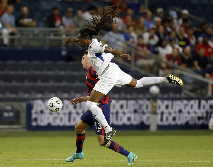 United States forward Matthew Hoppe, rear, and Martinique defender Dondon Gerald vie for the ball during the first half of a CONCACAF Gold Cup soccer match in Kansas City, Kan., Thursday, July 15, 2021. (AP Photo/Colin E. Braley)