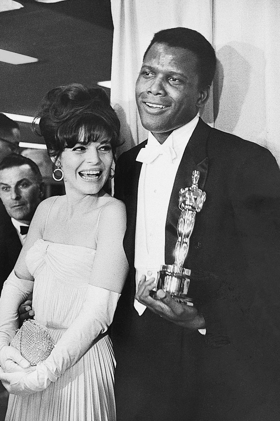 """<p><a href=""""http://www.history.com/this-day-in-history/sidney-poitier-wins-best-actor-oscar-for-lilies-of-the-field"""" rel=""""nofollow noopener"""" target=""""_blank"""" data-ylk=""""slk:Sidney Poitier made history"""" class=""""link rapid-noclick-resp"""">Sidney Poitier made history</a> when he became the first black man to win the award for Best Actor, thanks to his performance in <em><a href=""""https://www.amazon.com/dp/B000IZ8V9O?ref=sr_1_1_acs_kn_imdb_pa_dp&qid=1547582524&sr=1-1-acs&autoplay=0&tag=syn-yahoo-20&ascsubtag=%5Bartid%7C10055.g.5148%5Bsrc%7Cyahoo-us"""" rel=""""nofollow noopener"""" target=""""_blank"""" data-ylk=""""slk:Lilies of the Field"""" class=""""link rapid-noclick-resp"""">Lilies of the Field</a></em><span class=""""redactor-invisible-space"""">. Actress Ann Bancroft congratulated him with a kiss on the cheek, which conservative audiences at the time found scandalous. </span></p>"""