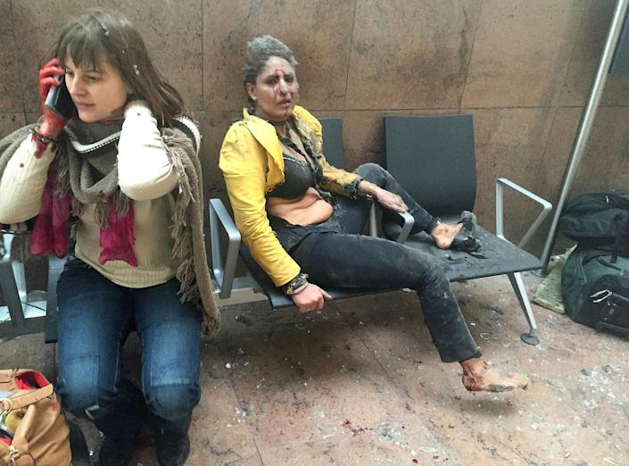 <p>MAR. 22 – 2016 — Flight attendant Nidhi Chaphekar (R) reacts in the moments following a suicide bombing at Brussels Zaventem airport in Brussels, Belgium. Georgian journalist Ketevan Kardava, special correspondent for the Georgian Public Broadcaster, was travelling to Geneva when the attack took place, she was knocked to the floor and began to take photographs in the moments that followed. At least 31 people were killed and more than 260 injured in a twin suicide blast at Zaventem Airport and a further bomb attack at Maelbeek Metro Station. (Ketevan Kardava/Getty Images) </p>