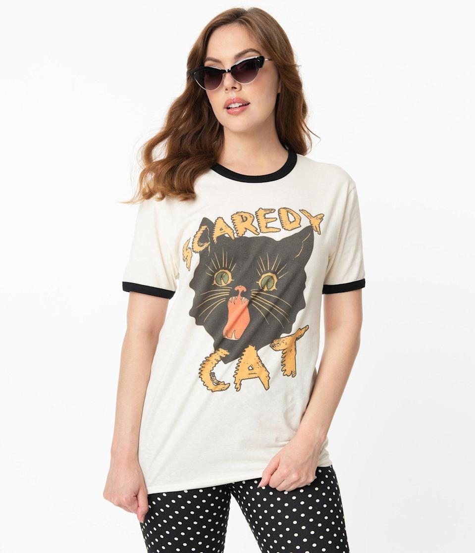 "<p>The <span>Cream and Black Scaredy Cat Unisex Tee</span> ($38) will bring your <a class=""link rapid-noclick-resp"" href=""https://www.popsugar.com/Halloween"" rel=""nofollow noopener"" target=""_blank"" data-ylk=""slk:Halloween"">Halloween</a> style back to life. </p>"
