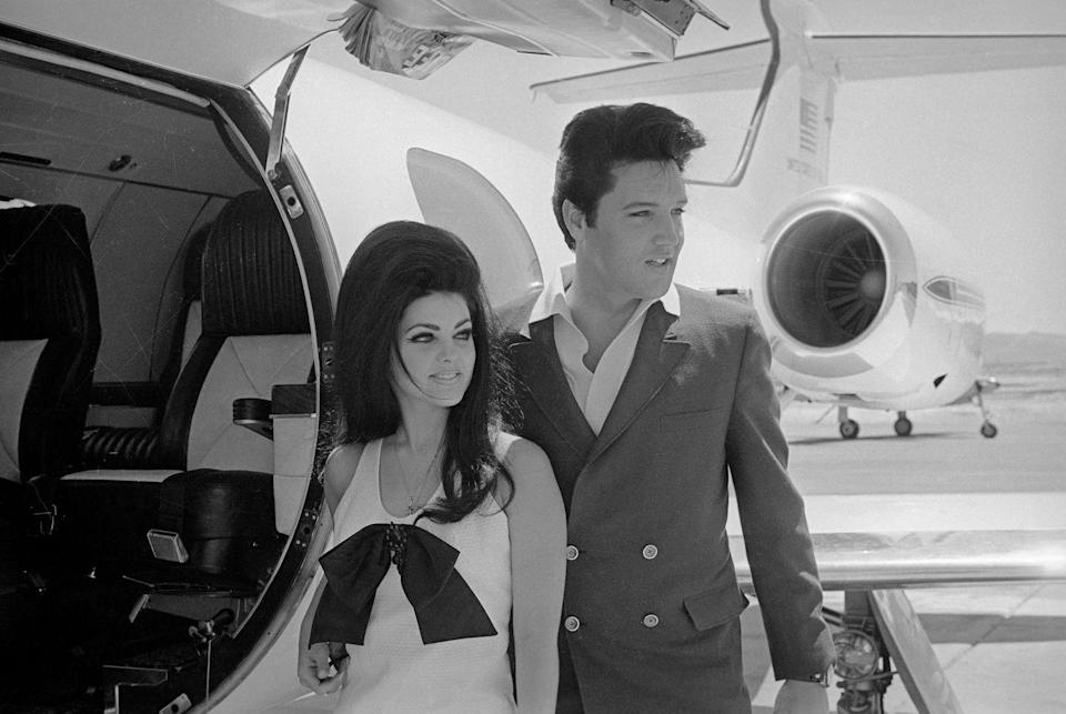 """<p>Two years after his discharge, Elvis invited Priscilla to join him in the United States. Now 17 years old, her parents allowed her to visit the star multiple times before the teenager moved to Memphis in 1963 to finish high school and <a href=""""https://www.mylifetime.com/she-did-that/june-7-1982-priscilla-presley-opened-graceland-to-the-public#:~:text=In%20March%201963%2C%20Priscilla%20convinced,moved%20into%20the%20main%20house."""" rel=""""nofollow noopener"""" target=""""_blank"""" data-ylk=""""slk:live with the rock star at Graceland"""" class=""""link rapid-noclick-resp"""">live with the rock star at Graceland</a>.</p>"""