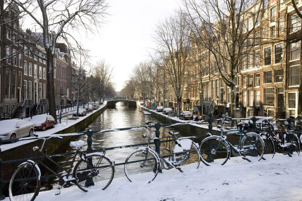 General view of Bicycles on a bridge over a canal in Amsterdam, Netherlands.