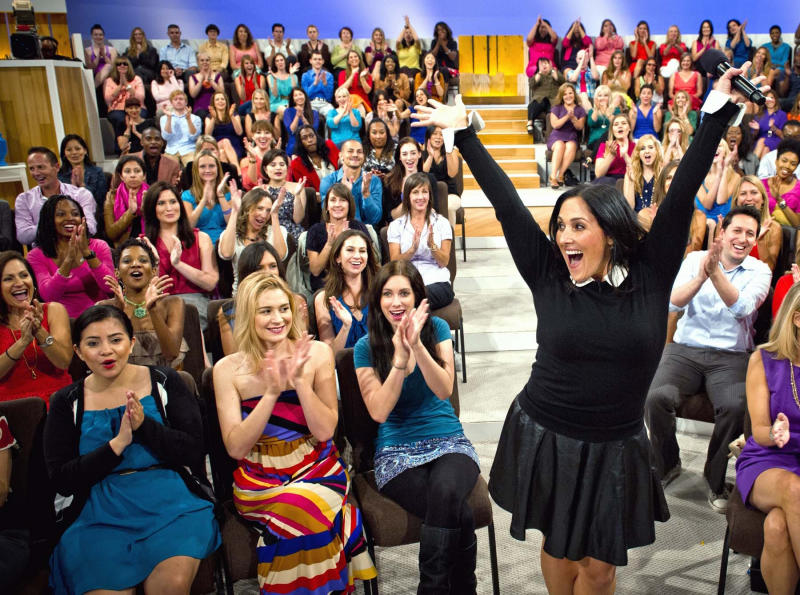 """FILE - This Wednesday, July 25, 2012 photo released by 20th Television shows host Ricki Lake with her audience during the first day of taping for her new daytime talk show, """"The Ricki Lake Show,"""" in Los Angeles. The nationally syndicated show, which will cover topics ranging from parenting, weight loss, health, beauty, career, and love, premieres on Sept. 10. (AP Photo/20th Television, Barry J. Holmes)"""