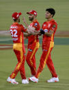 Islamabad United's Mohammad Wasim, right, celebrates with teammates after taking the wicket of Multan Sultans' Shahid Afridi during a Pakistan Super League T20 cricket match between Multan Sultans and Islamabad United at the National Stadium, in Karachi, Pakistan, Sunday, Feb. 21 2021. (AP Photo/Fareed Khan)