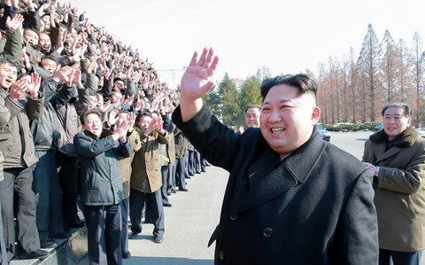 North Korean leader Kim Jong-un visiting the State Academy of Sciences at an undisclosed location - Credit: AFP