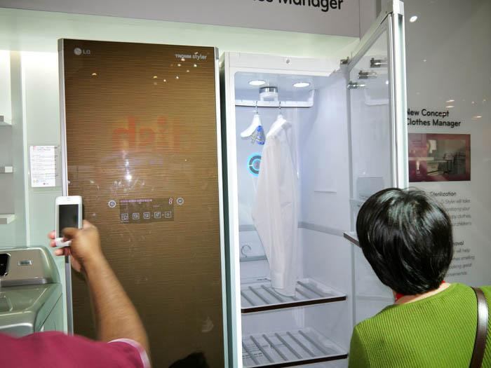 "Hoping to create a new class of appliance, the concept model from LG is a ""clothes manager"" that dries, removes odor, sterilizes, and takes the wrinkles out of clothing. (After a few days at CES, we could use one in the hotel room.) (Scott Ard/Yahoo! News)"