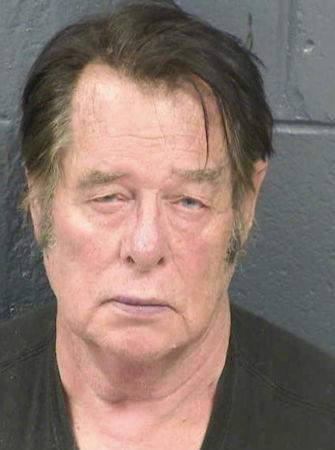 Larry Mitchell Hopkins appears in a police booking photo taken at the Dona Ana County Detention Center in New Mexico
