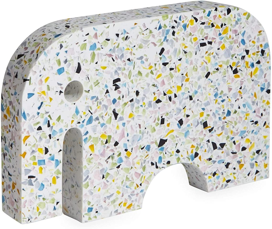 "<p>Decorate any tabletop or shelf with this fun <product href=""https://www.amazon.com/Now-House-Jonathan-Adler-Terrazzo/dp/B07G5QPY33/ref=sr_1_55"" target=""_blank"" class=""ga-track"" data-ga-category=""internal click"" data-ga-label=""https://www.amazon.com/Now-House-Jonathan-Adler-Terrazzo/dp/B07G5QPY33/ref=sr_1_55"" data-ga-action=""body text link"">Now House by Jonathan Adler Terrazzo Elephant</product> ($59).</p>"