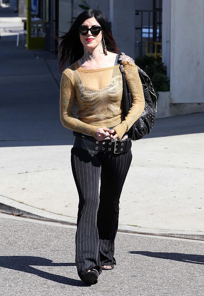 Nobody wears a tattered, off-the-shoulder, see-through sweater like tattooist Kat Von D. Nor should they. (3/20/2012)