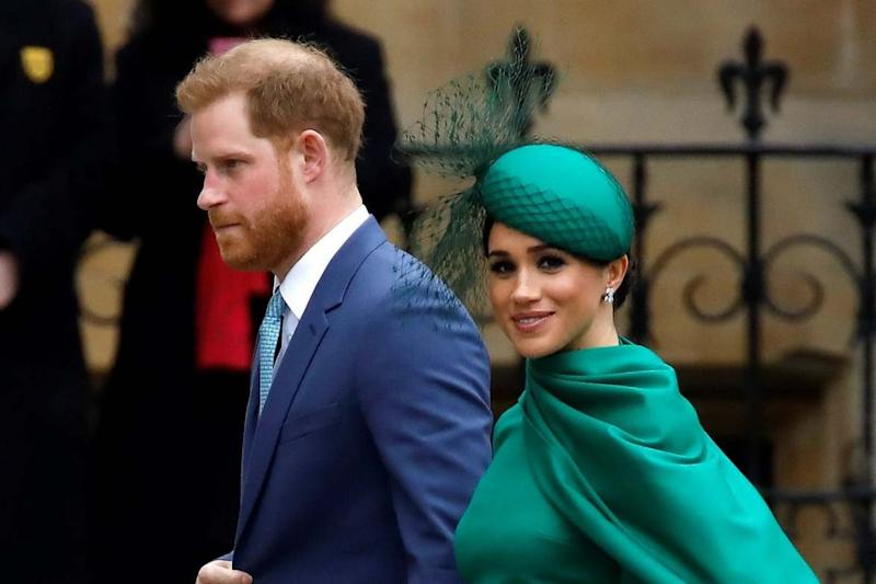 Prince Harry, Duke of Sussex, (L) and Meghan, Duchess of Sussex (AFP via Getty Images)