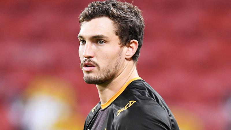 Corey Oates is pictured warming up for the Brisbane Broncos.