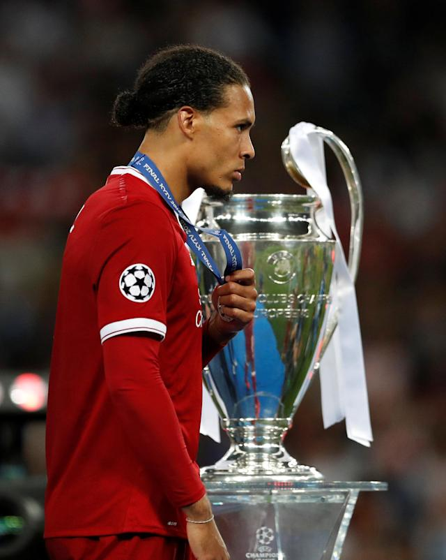 Soccer Football - Champions League Final - Real Madrid v Liverpool - NSC Olympic Stadium, Kiev, Ukraine - May 26, 2018 Liverpool's Virgil van Dijk looks dejected as he walks past the Champions League trophy during the medal ceremony after the match REUTERS/Andrew Boyers