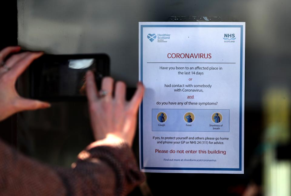 A general Coronavirus warning sign is visible at the entrance to a Hanover Scotland sheltered housing complex in Kilmarnock, East Ayrshire after it was confirmed a resident at one of their developments had recently returned from south-east Asia and reported feeling unwell. (Photo by Andrew Milligan/PA Images via Getty Images)