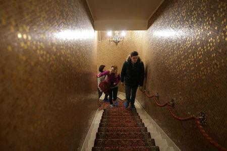 A tour guide leads the way for two Russian tourists during their visit at Romania's former communist dictator Nicolae Ceausescu' villa in Bucharest, Romania January 25, 2017.  Inquam Photos/Octav Ganea/via REUTERS