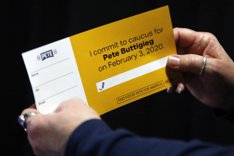 A woman holds a caucus card for Democratic presidential candidate former South Bend, Ind., Mayor Pete Buttigieg at a town hall meeting Tuesday, Jan. 28, 2020, in Indianola, Iowa (AP Photo/Sue Ogrocki)