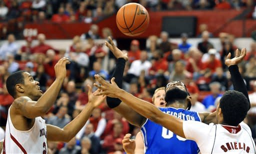 Creighton's Gregory Echenique (00) battles for a rebound with Nebraska's Dylan Talley, left, and Shavon Shields in the second half of their NCAA college basketball game, Thursday Dec. 6, 2012, in Lincoln, Neb. (AP Photo/Dave Weaver)