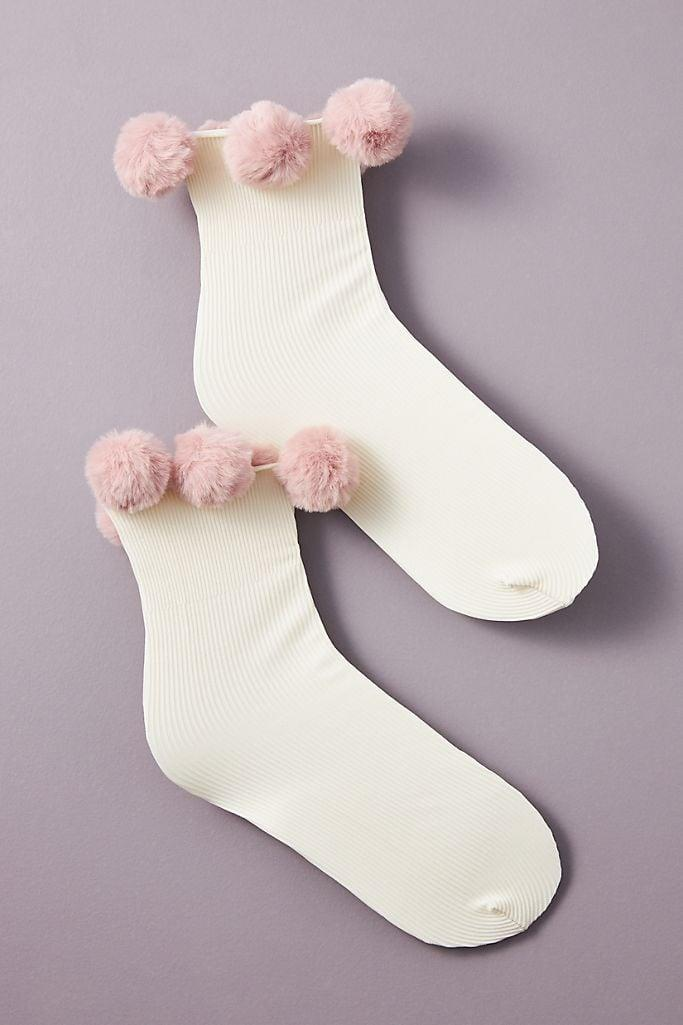 """<p><span>Anthropologie Ebba Pommed Ankle Socks</span> ($33) </p> <p>""""Whoever started the rumor that socks are a lame holiday gift clearly had never seen these Ebba Pommed Ankle Socks from Anthropologie. The fuzzy pink pom poms will add a touch of whimsy to any working-from-home 'fit."""" - VM</p>"""