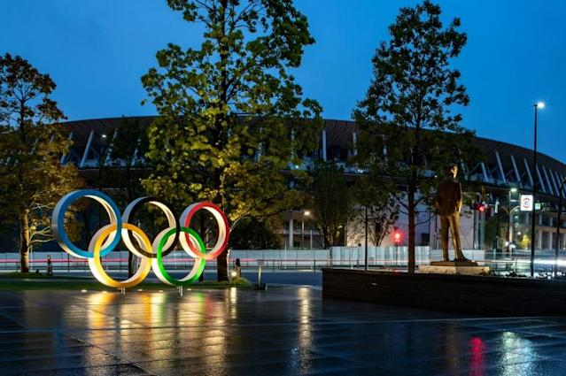 Officials in Japan and from the IOC have warned that it will not be possible to postpone the Olympics again (AFP Photo/Philip FONG)